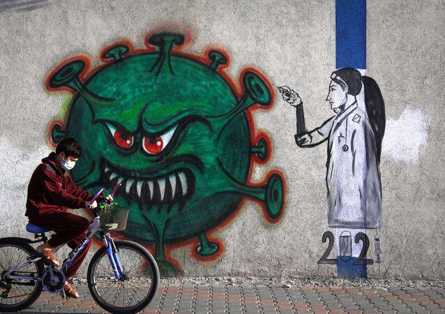 Mural z pielęgniarką i symbolem koronawirusa, Strefa Gazy