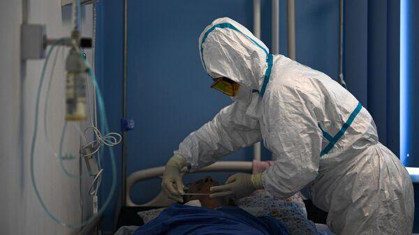 Pandemia koronawirusa SARS-CoV-2. - Sputnik Polska