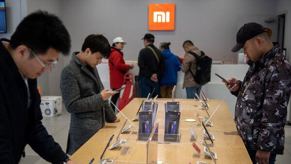Jeden ze sklepów Xiaomi w Pekinie. - Sputnik Polska