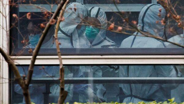 Eksperci Światowej Organizacji Zdrowia w Wuhan - Sputnik Polska