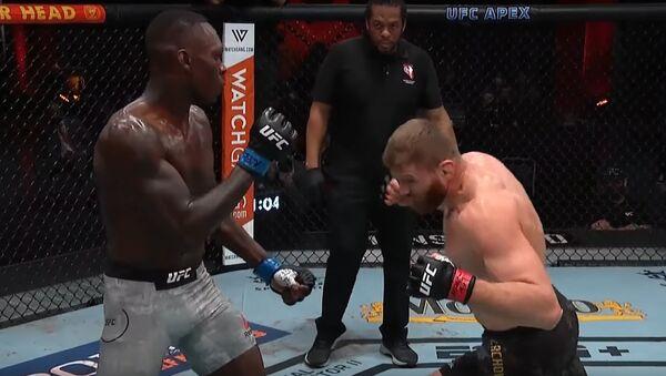 Walka o tytuł mistrza UFC wagi półciężkiej między Janem Błachowiczem a Israelem Adensayą - Sputnik Polska