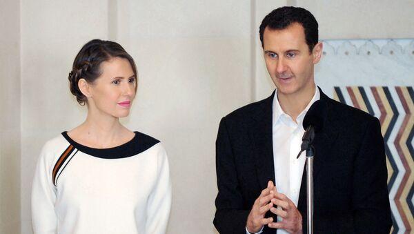 Prezydent Syrii Baszar al-Asad z żoną Asmą. - Sputnik Polska