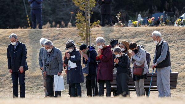 Japończycy uczcili minutą ciszy pamięć ofiar trzęsienia ziemi w 2011 roku - Sputnik Polska