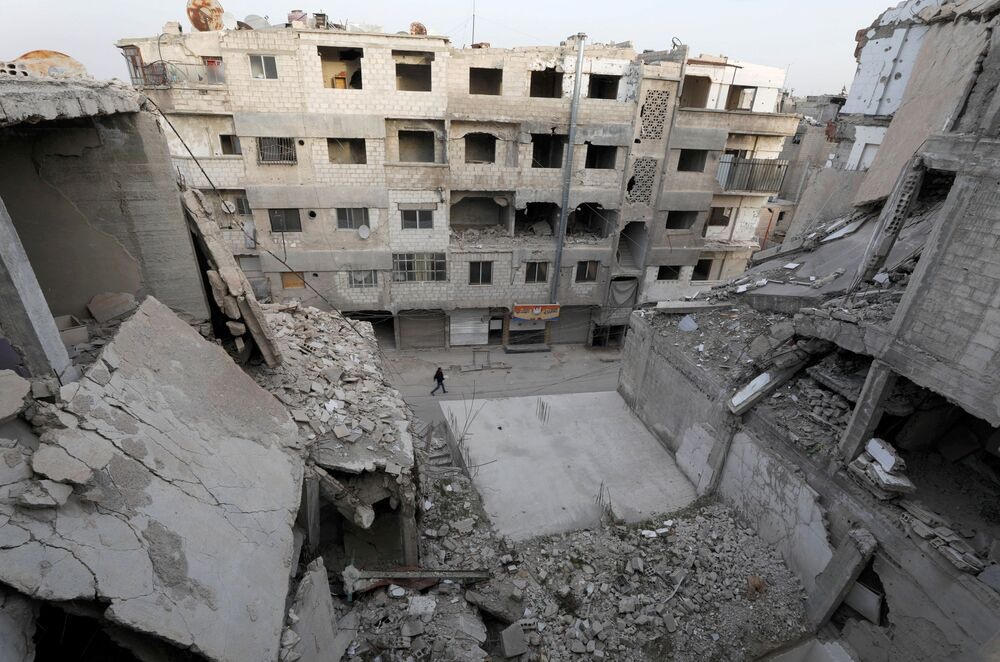 Zniszczone domy w syryjskim mieście Duma