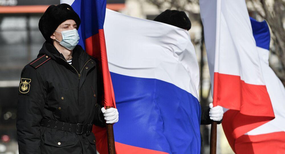 Uczestnicy wydarzeń poświęconych 7. rocznicy przyłączenia Krymu do Rosji.
