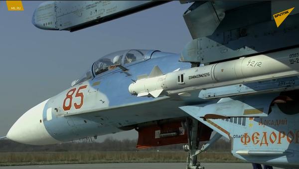 Su-27 podczas szkolenia w zakresie ochrony przestrzeni powietrznej Federacji Rosyjskiej - Sputnik Polska
