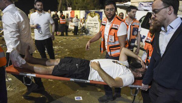 Co najmniej 44 osoby zginęły stratowane i ściśnięte przez tłum podczas święta religijnego w północnym Izraelu, 29 kwietnia 2021 roku - Sputnik Polska