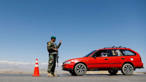 Żołnierz Afgańskiej Armii Narodowej na punkcie kontrolnym. Zdjęcie archiwalne. - Sputnik Polska