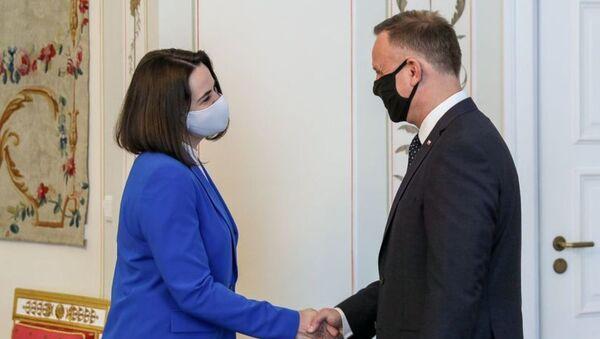 Swiatłana Cichanouska na spotkaniu z prezydentem Andrzejem Dudą - Sputnik Polska