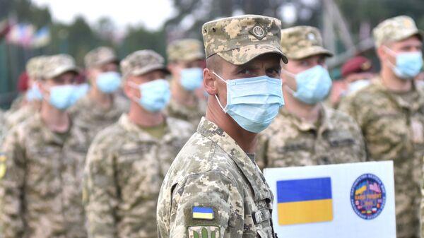 Ukraińscy żołnierze na ceremonii otwarcia wspólnych ćwiczeń wojskowych Ukrainy i państw NATO. - Sputnik Polska