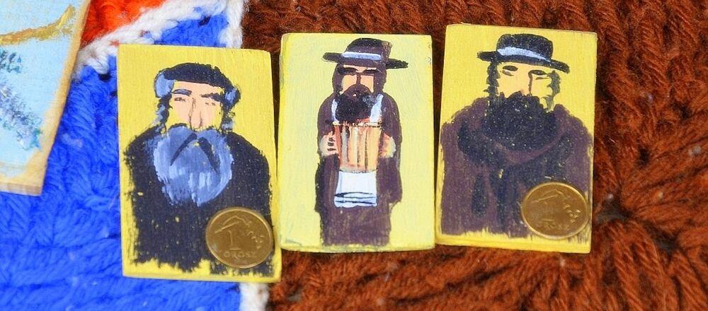 Przedstawianie Żyda z pieniążkiem, jako amuletu na powodzenie finansowe