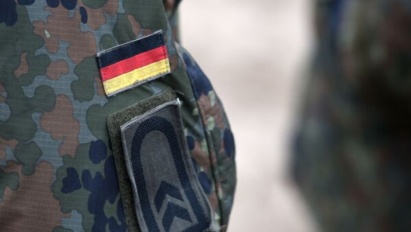 Niemiecka flaga na mundurze. - Sputnik Polska