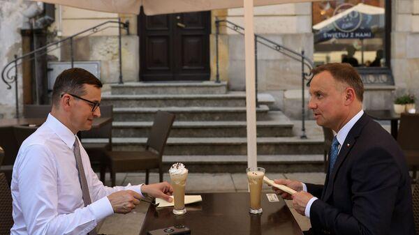Премьер-министр Матеуш Моравецкий и президент Республики Польша Анджей Дуда на встрече - Sputnik Polska