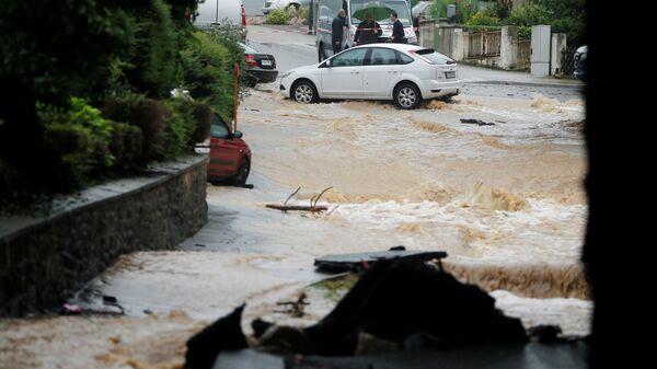 Затопленная улица после проливных дождей в Хагене, Германия  - Sputnik Polska