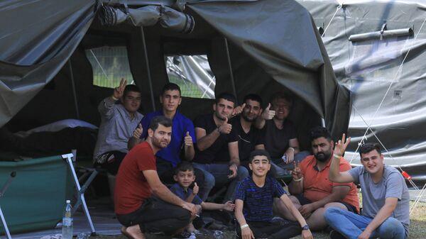 Мигранты в лагере недалеко от приграничного города Капчяместис, Литва - Sputnik Polska