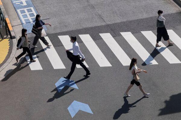 Na ulicach Tokio w przededniu otwarcia Igrzysk Olimpijskich 2020. - Sputnik Polska