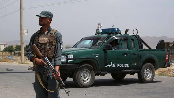 Сотрудник  национальной полиции Афганистана на КПП - Sputnik Polska