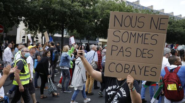 Митинги в национальный день протеста против обязательной вакцинации против Covid-19 , требуемого французским правительством, в Париже - Sputnik Polska