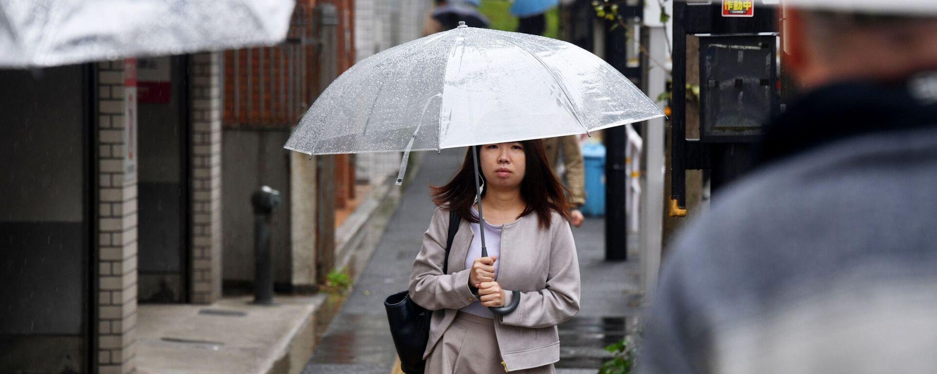 Dziewczyna pod parasolką w Japonii - Sputnik Polska, 1920, 14.08.2021