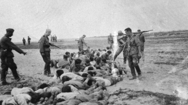 Казнь мирного населения на временно оккупированной территории Советского Союза. Архивное фото - Sputnik Polska