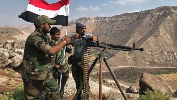Syryjska armia ustawiła flagę narodową na południowym zachodzie prowincji Dara na granicy z Jordanią - Sputnik Polska