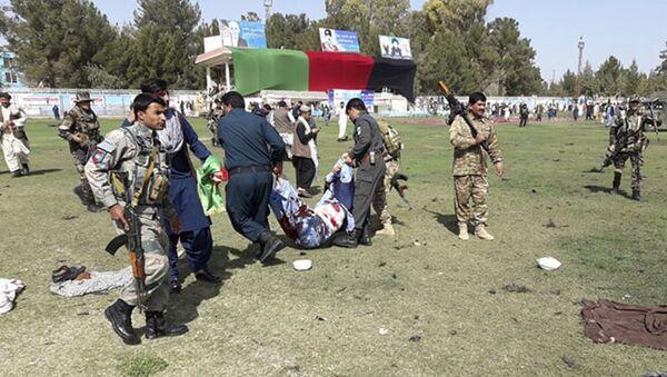 Последствия взрыва на стадионе в афганской провинции Гильменд во время празднования национального дня фермера - Sputnik Polska