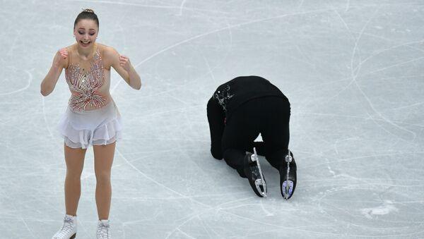 Aleksandra Bojkowa i Dmitrij Kozłówskij z Rosji wykonują dowolny program par na Mistrzostwach Świata w łyżwiarstwie figurowym w Saitame - Sputnik Polska