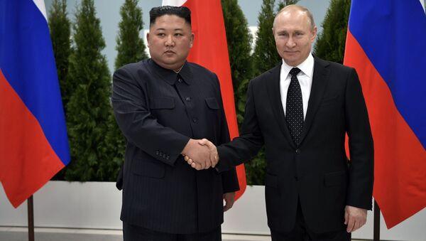 Prezydent Rosji Władimir Putin i przywódca Korei Północnej Kim Dzong Un - Sputnik Polska