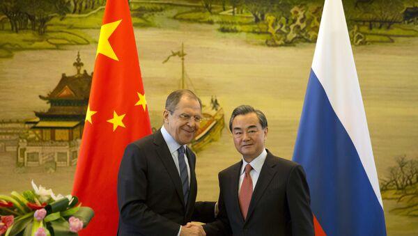 Minister spraw zagranicznych Rosji Siergiej Ławrow i chiński minister spraw zagranicznych Wang Yi na spotkaniu w Pekinie - Sputnik Polska