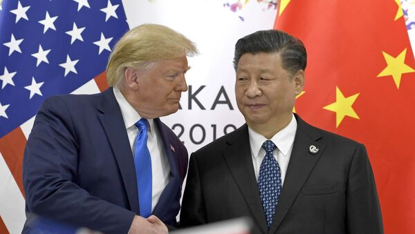 Prezydent USA Donald Trump i przewodniczący ChRL Xi Jinping na szczycie G20 w Osace - Sputnik Polska