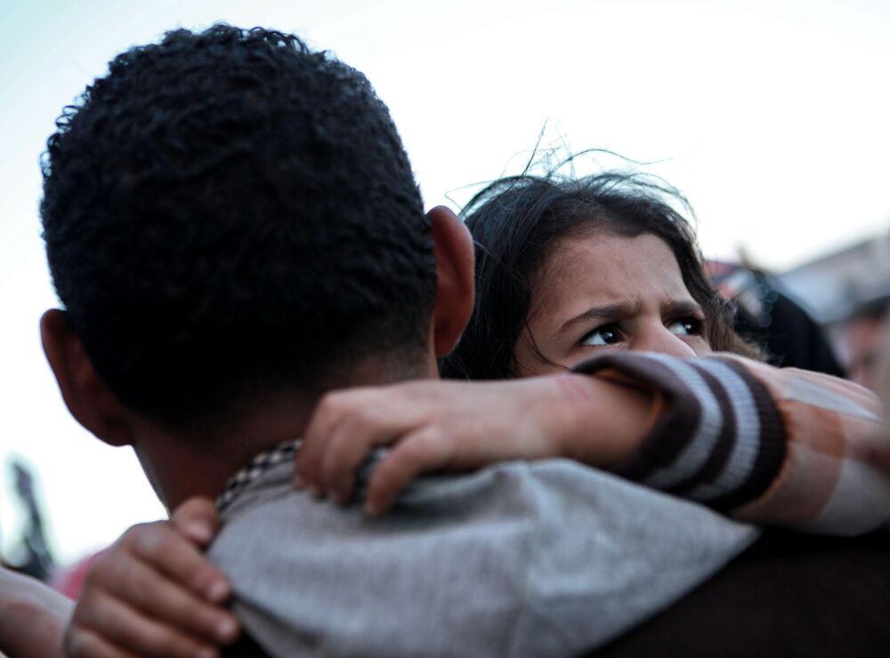 Uchodźcy w porcie Bengazi w Libii