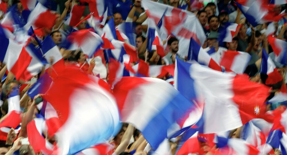 France's fans wave French flags during the France vs England rugby friendly match at Stade de France in Saint Denis, north of Paris, France, Saturday Aug. 22, 2015.
