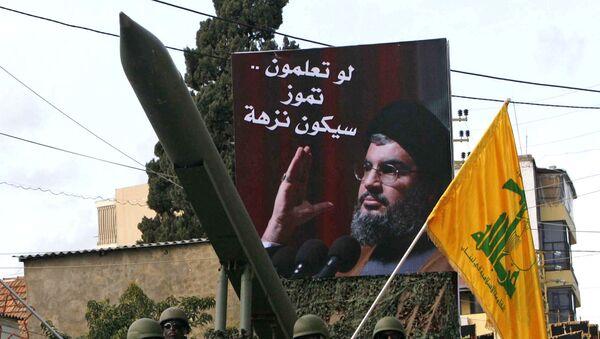 Członkowie libańskiego Hezbollahu podczas demonstracji w Nabatiyeh, 10.01.2009 - Sputnik Polska