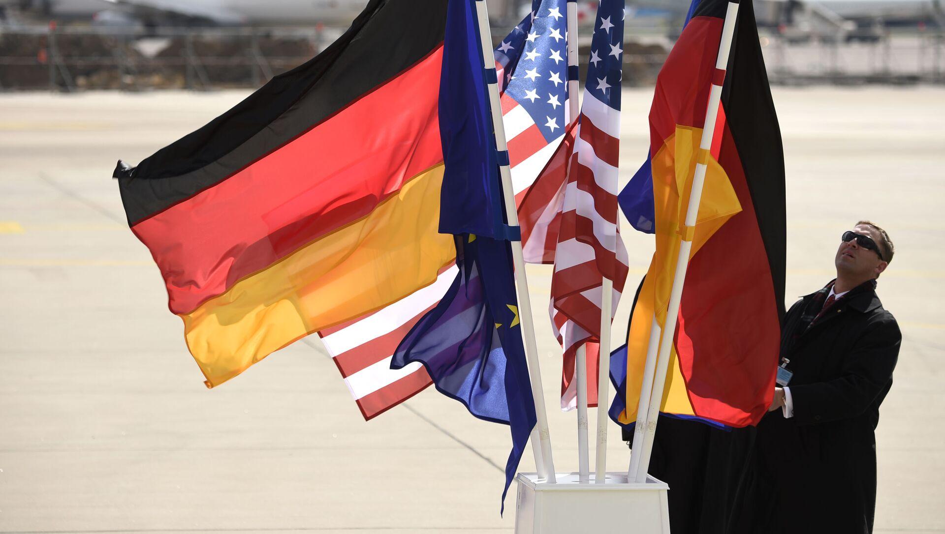 Flagi USA i Niemiec na lotnisku w Hanowerze - Sputnik Polska, 1920, 03.03.2021