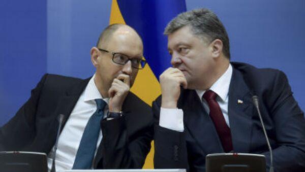 Premier Arsenij Jaceniuk i prezydent Petro Poroszenko - Sputnik Polska