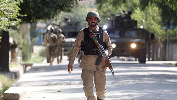 Oficer Sił Bezpieczeństwa Afganistanu na miejscu zdarzenia. Zdjęcie archiwalne - Sputnik Polska