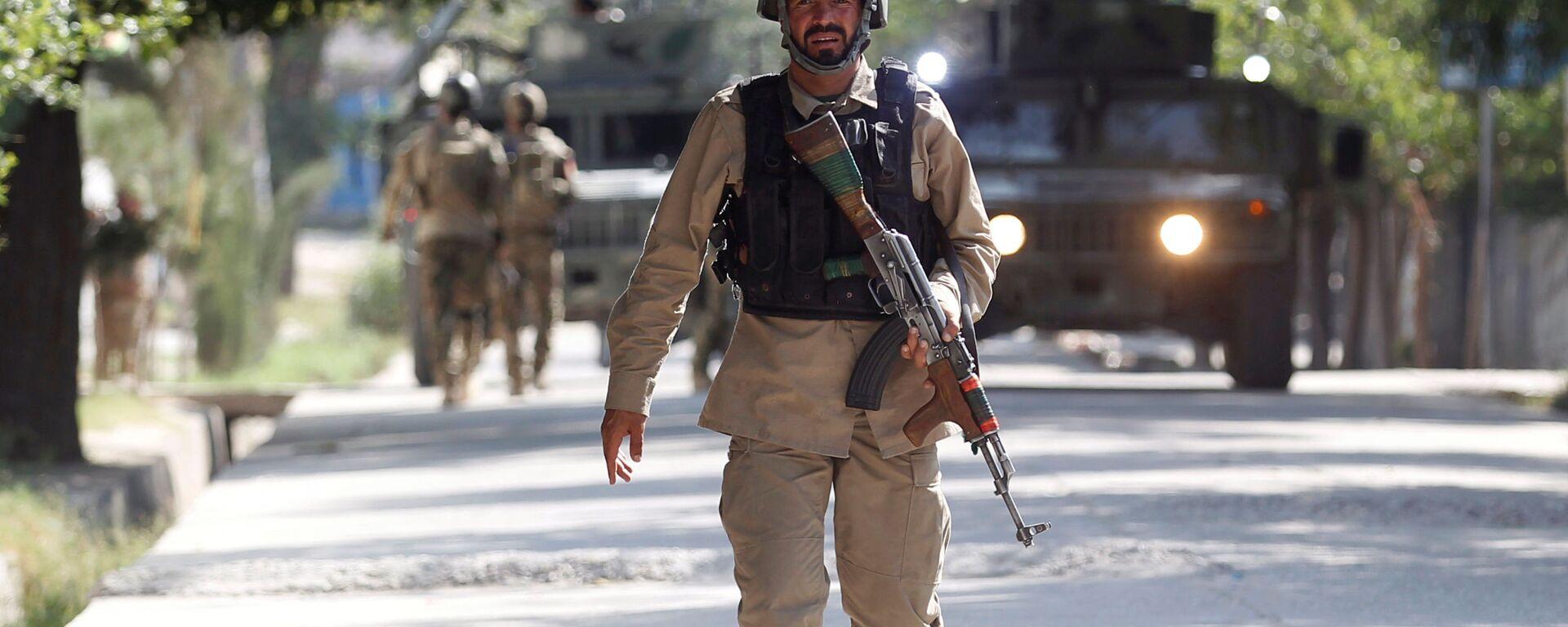 Oficer Sił Bezpieczeństwa Afganistanu na miejscu zdarzenia. Zdjęcie archiwalne - Sputnik Polska, 1920, 27.07.2021