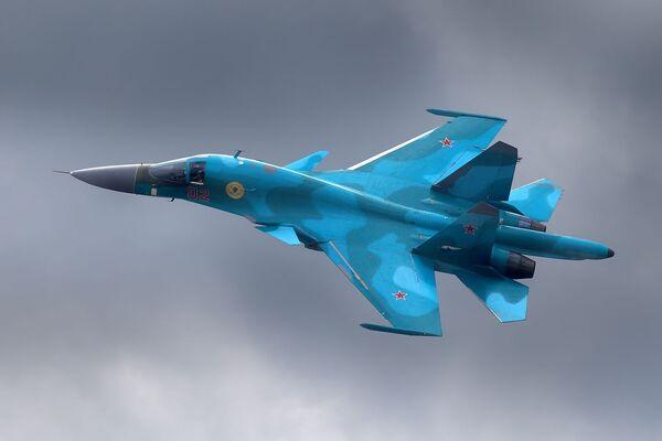 Rosyjski samolot myśliwsko-bombowy Su-34 - Sputnik Polska