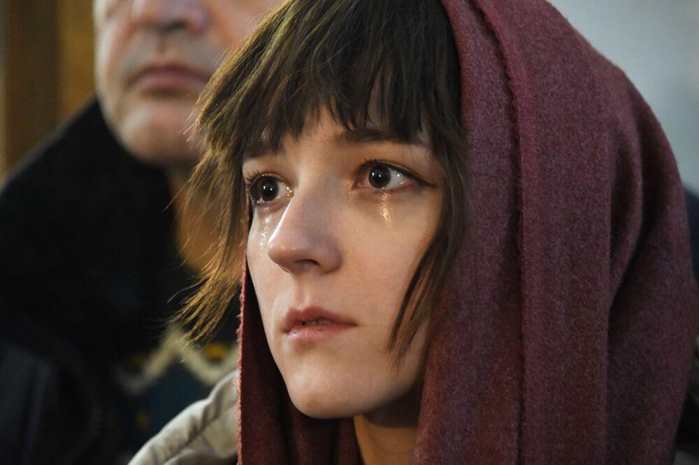 Kobieta w czasie liturgii bożonarodzeniowej w Czycie.