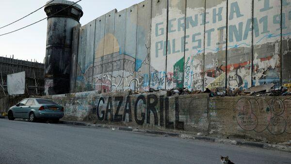Mur bezpieczeństwa w Betlejem na okupowanym przez Izrael Zachodnim Brzegu Jordanu.  - Sputnik Polska