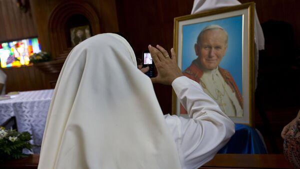 Z okazji 100. rocznicy urodzin papieża Jana Pawła II białoruscy katolicy wyruszą z pielgrzymką do Polski i Watykanu - Sputnik Polska