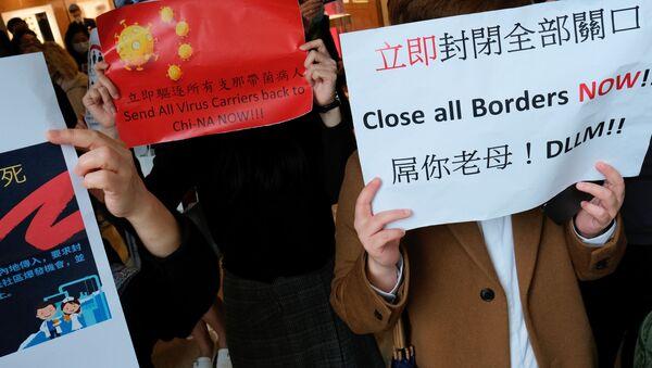 Pracownicy medyczni w Hongkongu strajkują, domagając się zamknięcia granicy z Chinami kontynentalnymi z powodu rozprzestrzeniania się koronawirusa - Sputnik Polska
