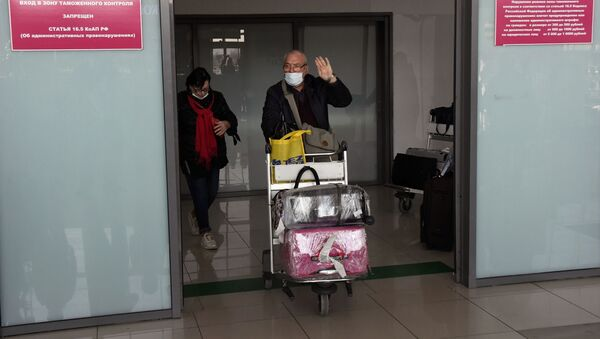 Rosyjscy turyści, którzy wrócili z Chin. - Sputnik Polska