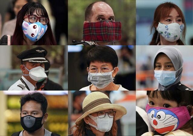 Ludzie w różnych maskach w porcie lotniczym, Malezja