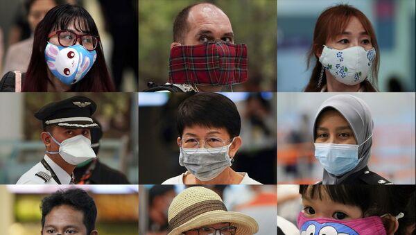 Ludzie w różnych maskach w porcie lotniczym, Malezja   - Sputnik Polska