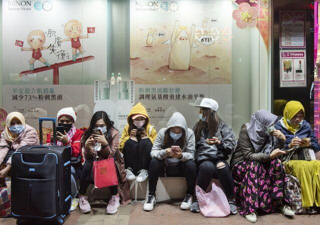 Kobiety w maskach ochronnych, Hongkong