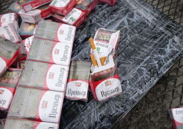 Paczki papierosów w węglu, transportowanym z Rosji do Polski