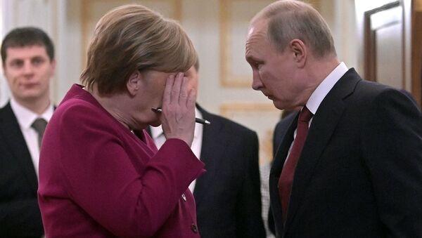 Prezydent Rosji i Angela Merkel - Sputnik Polska