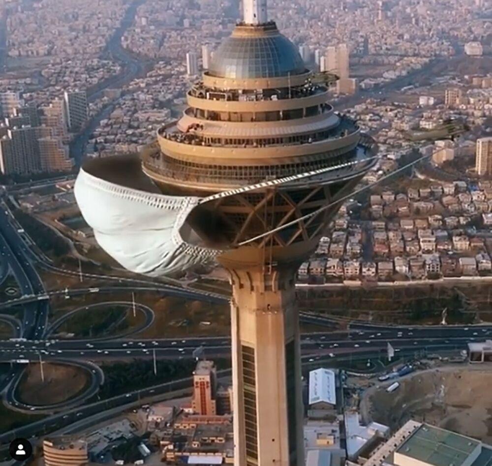 """Irański artysta wykorzystując modelowanie i animację, """"nałożył"""" gigantyczną maskę medyczną na wieżę Bordż-e Milad w Teheranie"""