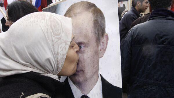 Syryjka w akcji poparcia na rzecz Rosji w Damaszku, Syria - Sputnik Polska